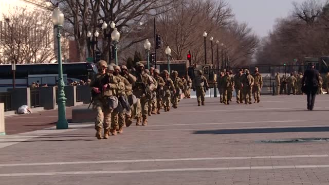 national guard patrolling us capitol grounds, armed soldiers, military trucks blocking roads - security stock videos & royalty-free footage