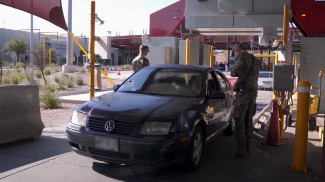National Guard personnel are conducting vehicle and driver traffic checks inspecting cargo assisting with xray machine operations and completing...