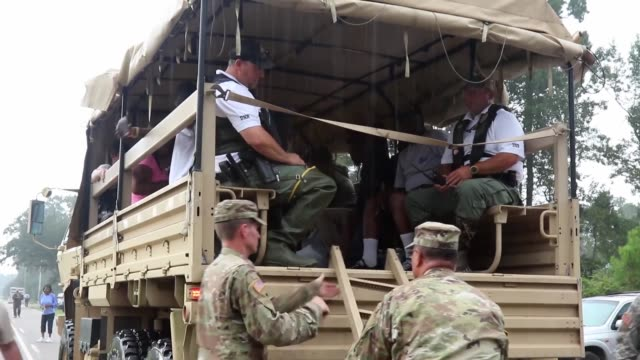 national guard soldiers and civilian search and rescue teams continue to provide support to residents as floodwaters continue to rise in south... - rescue worker stock videos & royalty-free footage