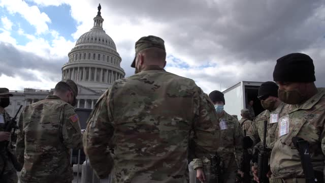 national guard soldiers are issued their m4 rifles and ammunition on the east front of the u.s. capitol on january 17, 2021 in washington, dc. after... - capitol building washington dc stock videos & royalty-free footage