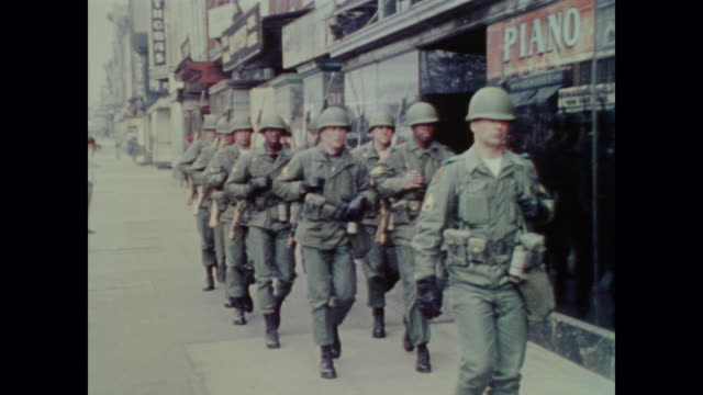vídeos y material grabado en eventos de stock de national guard soldiers march as a group down the city streets before meeting up with other guards and receiving directions - 1968