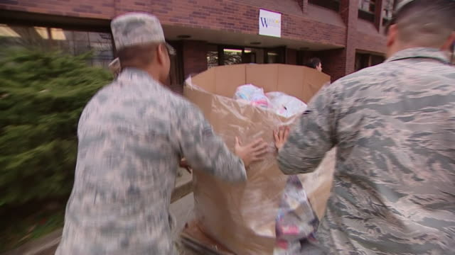 national guard soldiers providing assistance to families in new rochelle during the coronavirus outbreak - a helping hand stock videos & royalty-free footage