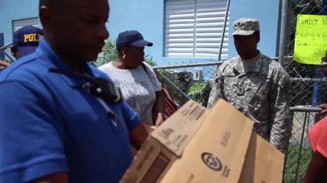 national guard soldiers travel by barge to aid hurricane survivors providing tarps nonperishable food water hygiene products and other specialty... - st. john virgin islands stock videos & royalty-free footage