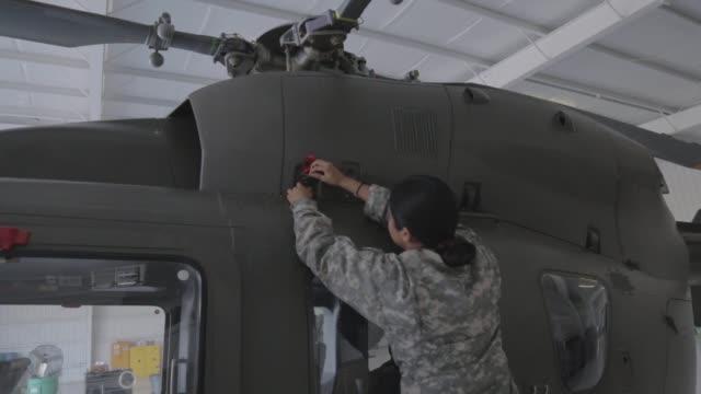 vídeos y material grabado en eventos de stock de national guard texas carry out preflight checks and operations prior to taking off from mcallen texas in a uh72 lakota helicopter the national guard... - accesorio financiero