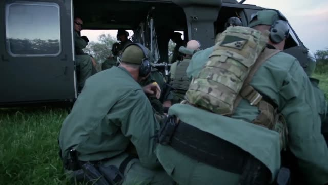 national guard uh60 blackhawk helicopters participating in operation guardian support arrived to assist tucson sector border patrol agents with... - camouflage clothing stock videos & royalty-free footage