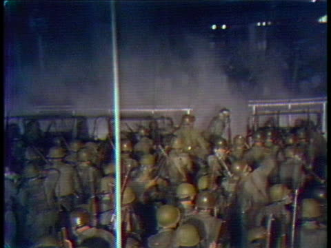 national guardsmen approach protesters with barricades and tear gas outside the 1968 democratic national convention. - 1968 bildbanksvideor och videomaterial från bakom kulisserna