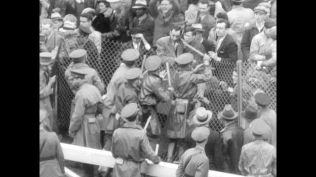 / National Guardsmen fight back unruly crowd at Churchill Downs as they try to push down the fencing Gate crashers at 61st Kentucky Derby on May 04...
