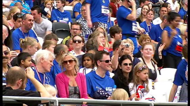 national lottery anniversary run at olympic stadium crowd in stadium - オリンピックスタジアム点の映像素材/bロール