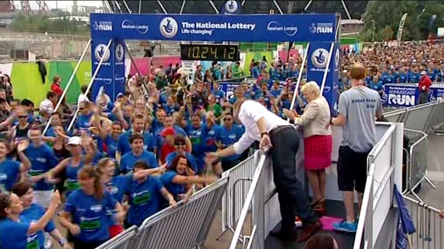 national lottery anniversary run at olympic stadium olympic stadium contestants lined up at start of race paula radcliffe receiving a cheer bv sir... - radcliffe camera stock videos and b-roll footage