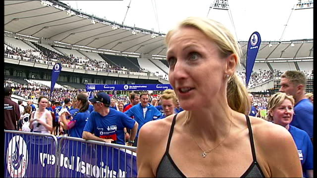 national lottery anniversary run at olympic stadium; victoria pendleton interview sot paula radcliffe interview sot runners wrapped in foil blankets... - anniversary stock videos & royalty-free footage
