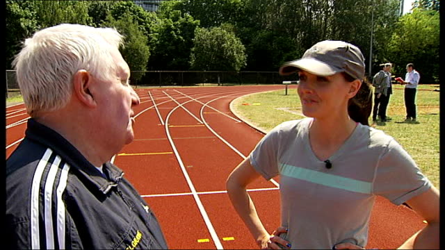 national lottery anniversary run: victoria pendleton to take part; england: london: battersea: ext victoria pendleton chatting to david lucas sot... - anniversary stock videos & royalty-free footage
