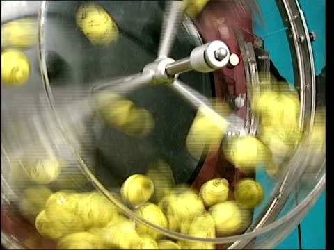 camelot over optimistic about money raising lib yellow balls falling into drum of lottery machine balls being spun in drum of machine ball being... - lotterie stock-videos und b-roll-filmmaterial