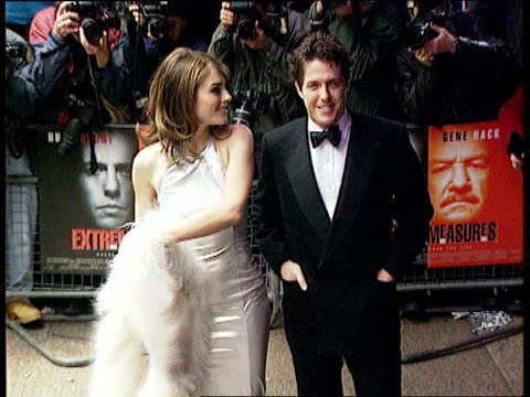 National Lottery new Wednesday draw London Leicester Square Hugh Grant girlfriend Liz Hurley at 'Extreme Measures' premiere