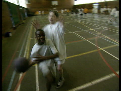 stockvideo's en b-roll-footage met proceeds awarded to sports projects itn england west midlands sutton coldfield the arthur terry school ms schoolboys towards as practising basketball - west midlands