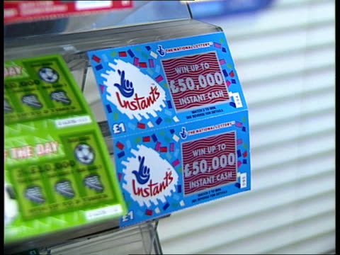 national lottery, sales to children; england: yorkshire: leeds gv newsagency of naheem bashir who was fined for selling lottery tickets to under 16's... - scratch card stock videos & royalty-free footage