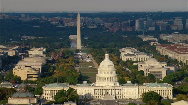 low aerial national mall, washington monument, library of congress, u.s. capitol and u.s. supreme court buildings, washington d.c., usa - washington monument washington dc stock videos & royalty-free footage