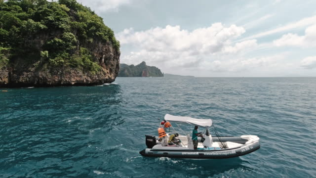 national marine park ranger police patroling phi phi islands thailand - eco tourism video stock e b–roll