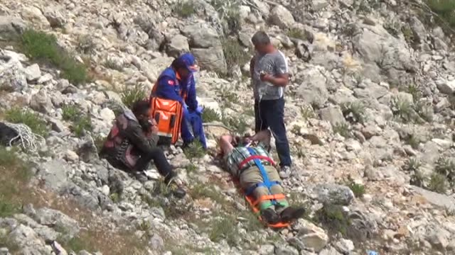 national medical rescue team give medical care to wounded german paraglider gunter kupka at the age of 59 in fethiye district of mugla province in... - fethiye stock videos and b-roll footage