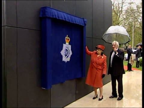 national memorial unveiled for officers killed in the line of duty england london queen elizabeth ii in red and black suit and carrying umbrella... - memorial plaque stock videos and b-roll footage