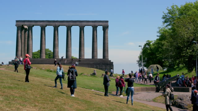 national monument of scotland & the portugese cannon, calton hill, edinburgh, scotland - calton hill national monument stock videos and b-roll footage