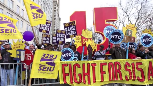 vídeos y material grabado en eventos de stock de a national movement 'fight for $15' including workers and labor unions rally on behalf of lowincome workers nationwide to raise the minimum wage to... - salarios