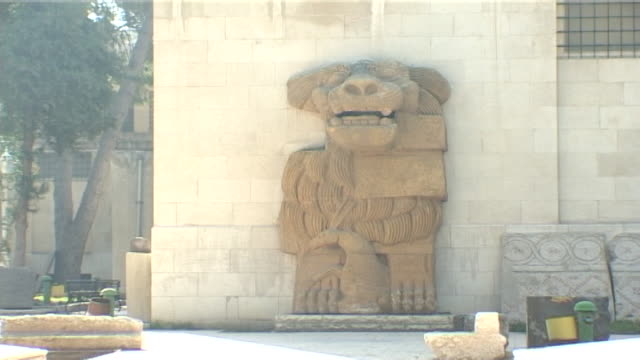 national museum of damascus. view of a palmyrene lion statue in the gardens of the museum. - ancient stock videos & royalty-free footage