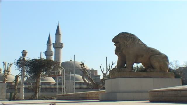 national museum of damascus. view of an antique lion sculpture in the gardens of the museum. the ottoman era tekkiye mosque can be seen in the... - ancient stock videos & royalty-free footage
