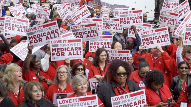 national nurses united and other organizations protested outside of the pharmaceutical research and manufacturers of american headquarters on april... - 労働組合点の映像素材/bロール