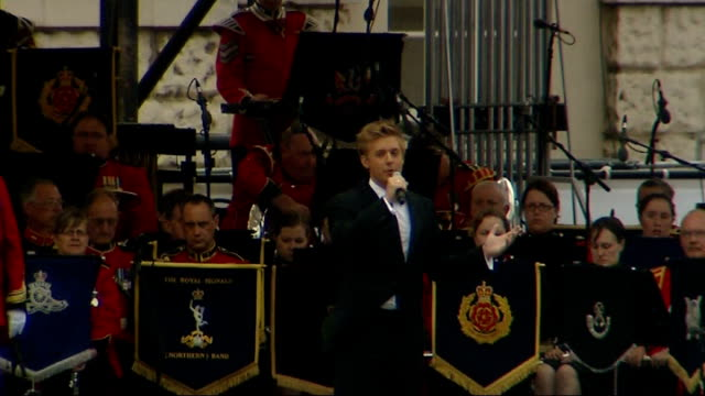 national pageant; england: london: horseguards' parade: ext opera singer jonathan ansell performs song an stage at territorial army pageant... - singer stock videos & royalty-free footage