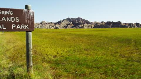 national park sign badlands south dakota landscape usa - badlands stock videos & royalty-free footage