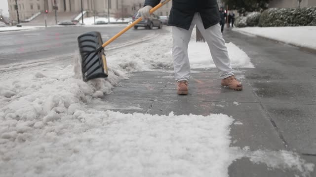 national parks service employees shovel and remove snow in washington dc us on tuesday march 14 2017 shots view of sidewalk being shoveled by workers... - snow vehicle stock videos and b-roll footage