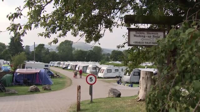 national parks warn of 'fly-campers' leaving behind equipment; england: derbyshire: peak district: ext people hiking along through valley traffic... - camping stock videos & royalty-free footage