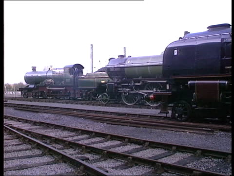 vídeos y material grabado en eventos de stock de national railway museum reopens england york gv steam which clears and steam engine seen ms side engine driver and stoker in cab of steam engine pull... - ceremonia de reapertura