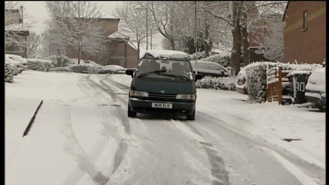 national salt shortage affects roads car sliding and skidding on snowcovered road - rutschen stock-videos und b-roll-filmmaterial