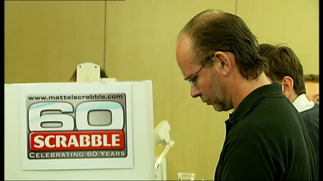 national scrabble championship won by allan simmons england west london cavendish conference centre int various shots of craig beevers and allan... - john craven stock videos & royalty-free footage