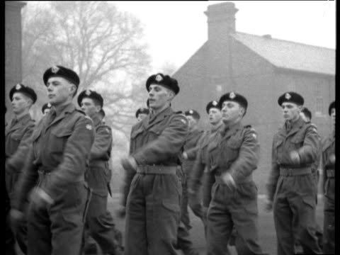 national service soldiers march in file look at camera and salute 1956 - 1956 stock-videos und b-roll-filmmaterial