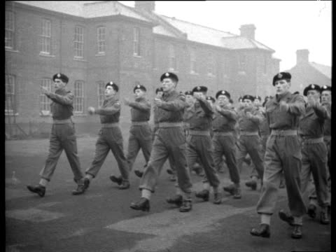vídeos de stock, filmes e b-roll de national service soldiers march in line salute turn around and march off 1956 - uniforme militar