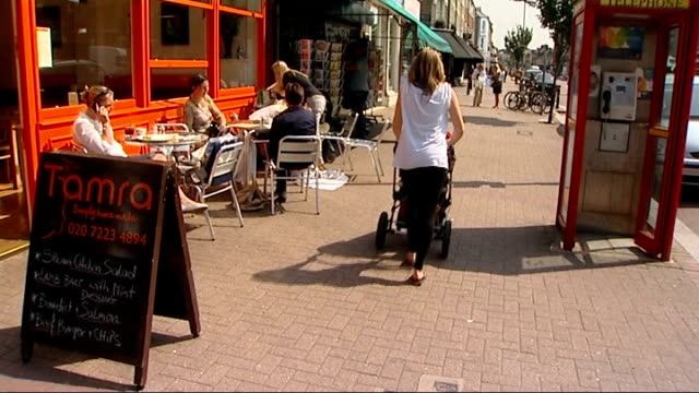 stockvideo's en b-roll-footage met national sperm bank opens in birmingham t25051004 / tx london wandsworth ext various shots women with prams and pushchairs along street - wandsworth