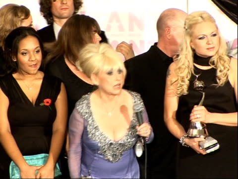 red carpet arrivals and backstage Barbara Windsor photocall continued/ Barbara Windsor answering press questions SOT