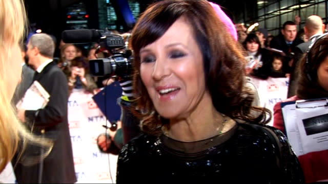 national television awards 2010: celebrity red carpet arrivals and interviews; arlene phillips interview sot - on performing - she is moving to music... - ストリクトリーカムダンシング点の映像素材/bロール