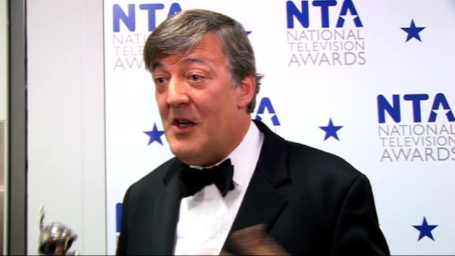 national television awards 2010: celebrity red carpet arrivals and interviews; stephen fry interview sot - on being in a room with his peers / on... - stephen fry stock videos & royalty-free footage