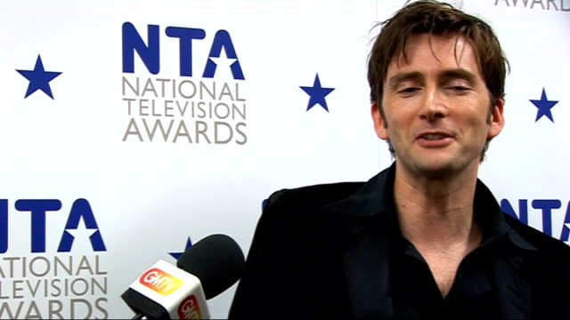 celebrity red carpet arrivals and interviews david tennant interview sot on winning / on matt smith taking over on doctor who attention hard at first... - doctor who stock videos & royalty-free footage
