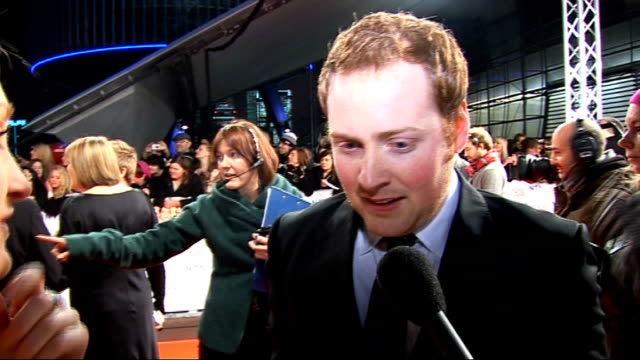 celebrity red carpet arrivals and interviews barbara windsor talking to press sot / gvs charlie clements talking to fans clements interview sot on... - イーストエンダーズ点の映像素材/bロール