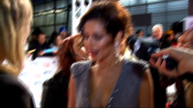 national television awards 2010: celebrity red carpet arrivals and interviews; gvs of cowell and cheryl cole signing autographs and on the carpet... - バンド アメリカ点の映像素材/bロール