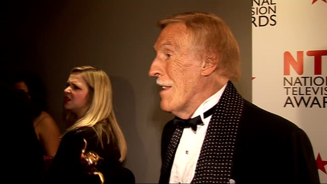 national television awards 2011: celebrity arrivals; bruce forsyth interview sot - on 02 arena - massive and frightening / on awards - clips of... - cameo brooch stock videos & royalty-free footage