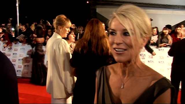 national television awards 2011: celebrity arrivals; gvs zoe lucker talking to press zoe lucker interview sot - on her outfit / on feelings - excited... - イーストエンダーズ点の映像素材/bロール