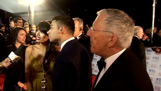 celebrity arrivals nick hewer interview sot on 'junior apprentice' / on new 'apprentice' format winner will get to go into business with lord sugar... - chin stock videos and b-roll footage