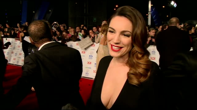 Red carpet interviews Kelly Brook posing for press / people along on red carpet / Brook chatting to press / people on red carpet Kelly Brook...