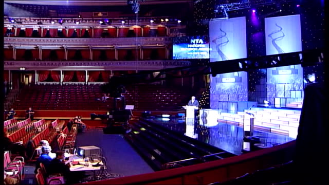 NINA NANNAR ENGLAND London Royal Albert Hall Auditorium prepared for the National Television Awards Sir Trevor McDonald seen on video screen McDonald...