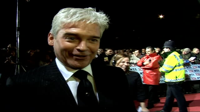 red carpet arrivals and interviews / winners room photocalls and interviews phillip schofield waving at fans / schofield speaking to press sot /... - phillip schofield stock videos & royalty-free footage